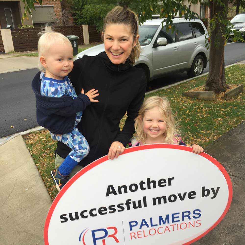 Happy Customer Holding a Palmers Sign
