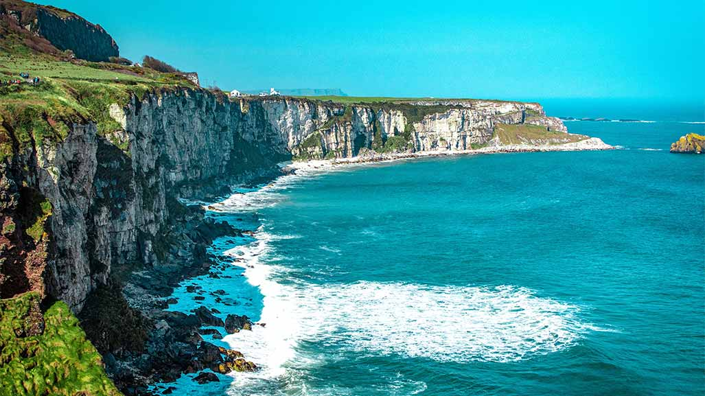 coast in ireland with blue ocean and waves