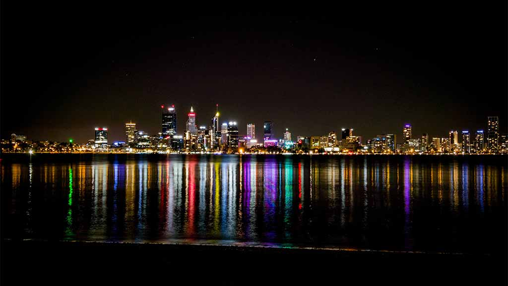 perth cbd lights reflecting on the swan river at night time