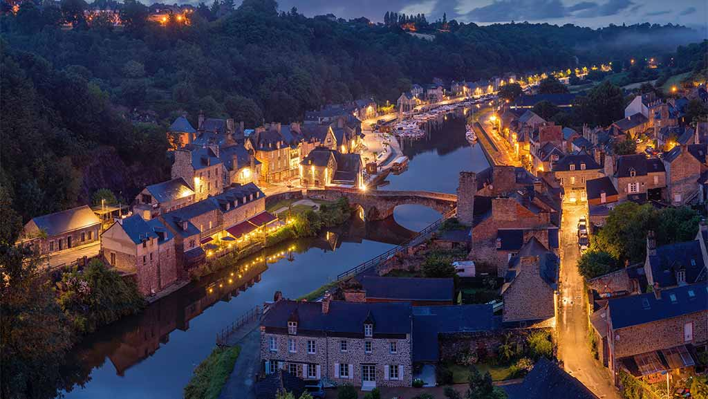 small village in france with lights and a river